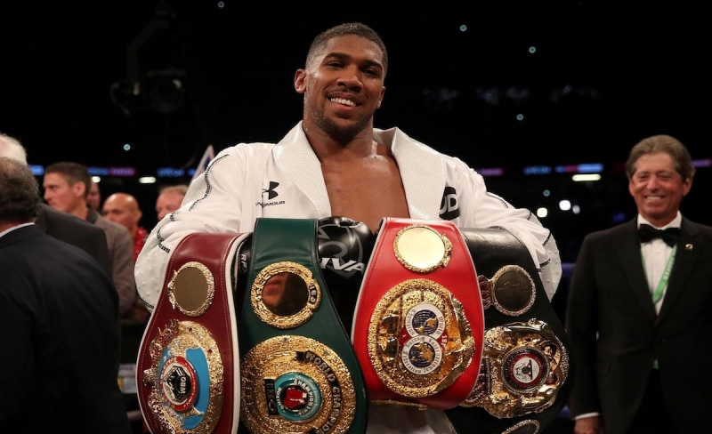 Anthony-Joshua with his belts
