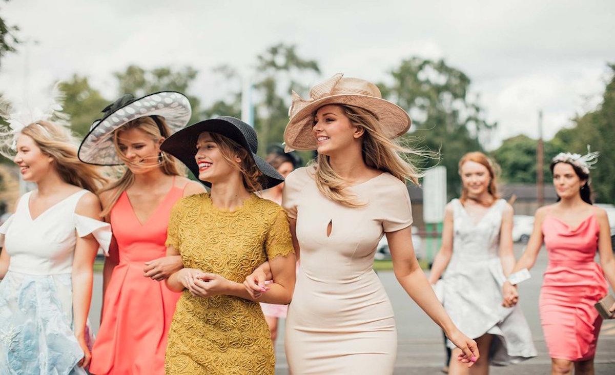 young women walking towards the race course of kentuky derby